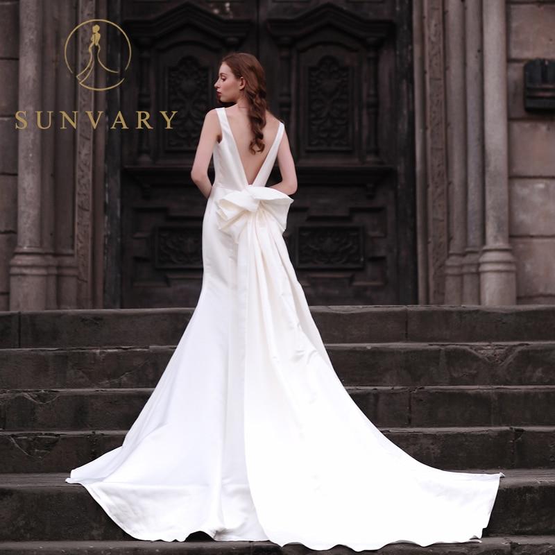 573b08901610 Sunvary High end Custom White Satin Wedding Dresses Long Chapel Handmade  Bow Sash Lower Backless Ball Gown Bridal Dresses-in Wedding Dresses from  Weddings ...
