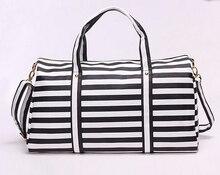 แฟชั่นผู้ชายผู้หญิงกระเป๋าเดินทางสีดำสีขาวความจุขนาดใหญ่Messenger:หนังpuกระเป๋าที่มีซิปไหล่กระเป๋าถือh-658