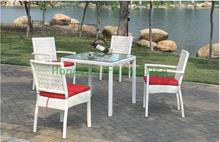 Outdoor rattan dining set with cushions and glass