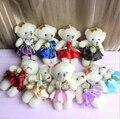Nuevo 12 CM 12 unids/lote pp algodón juguetes para niños mini muñeca de la felpa pequeño oso flor ramos de flores para la boda