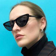 3384288d85 Caliente Sexy rojo ojo de gato gafas de sol de las mujeres europeas y  americanas tonos