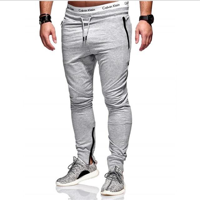 2018 hombres pantalones largos Mediados de algodón deportivo hombres  entrenamiento fitness pantalones moda casual jogger pantalones 45104581568d