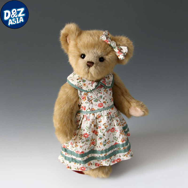 Мишка плюшевый в платье