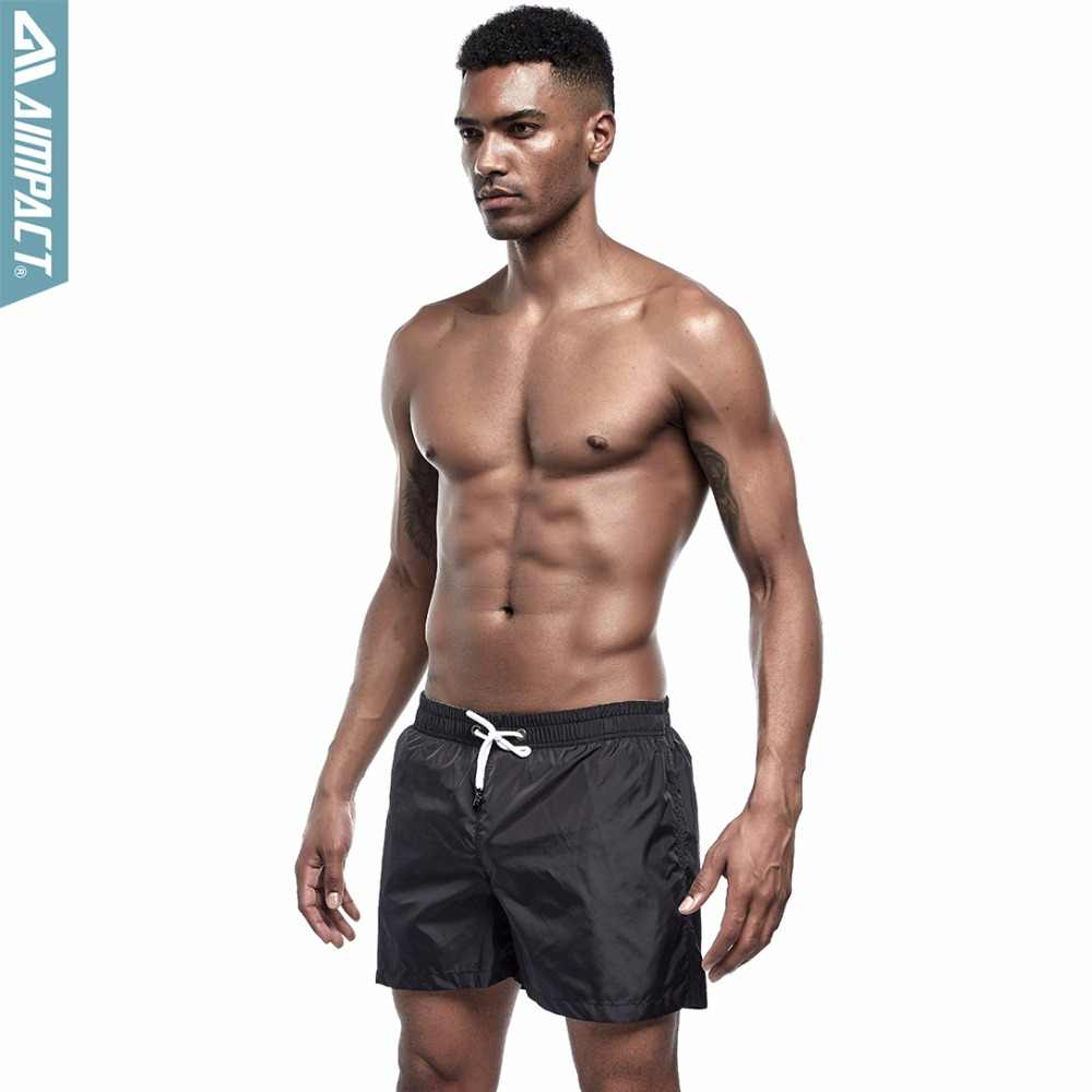 Marca AIMPACT, pantalones cortos de secado rápido para hombre, pantalones cortos de playa de moda sólidos, bañadores de natación activos informales, pantalones cortos de gimnasio para hombre E303