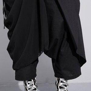 Image 5 - [EAM] 2020 New Spring di Alta Elastico In Vita Nero Piega Fasciatura Punto Lungo Allentato Cross pantaloni Delle Donne Dei Pantaloni di modo JF897