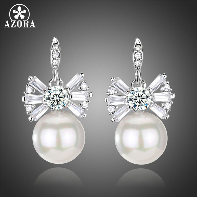 Azora Light Ivory Pearl Drop Vintage Bridal Bowknot Earrings With White Gold Color Round Cut Clear
