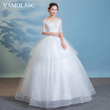 VAMOLASC Crystal Boat Neck Tiered Lace Ball Gown Wedding Dresses Illusion Pearls Half Sleeve Backless Bridal Gowns