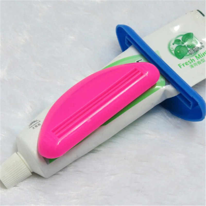 1PCS Squeeze Tube Rolling Holder Device Squeeze Toothpaste Out Lotions Cosmetics Avoid Wasting ABS New