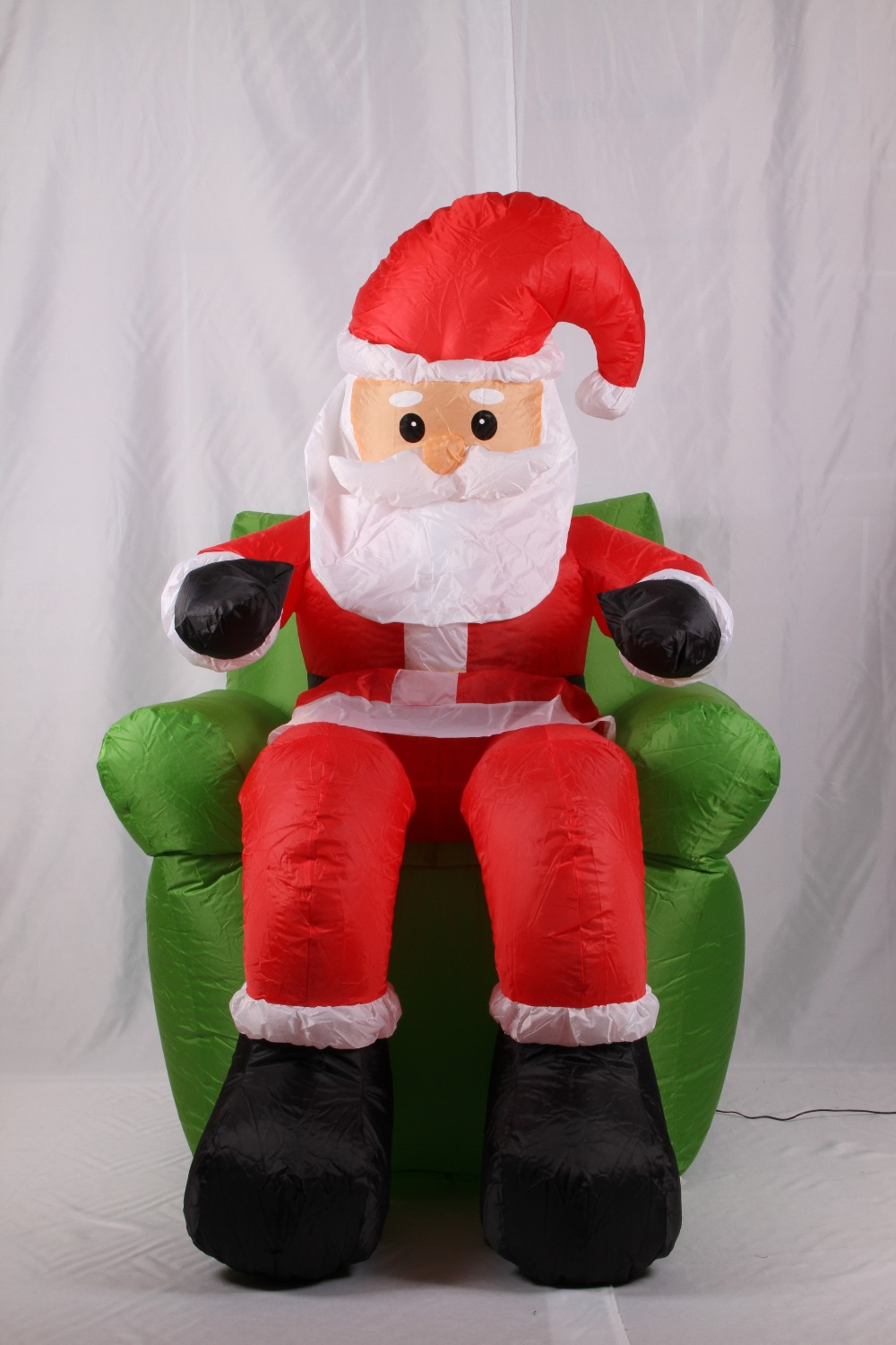 2017 Vioslite 1.8M Inflatable Christmas Santa Sitting in Sofa in High Quality for Festival Decoration 5m high big inflatable christmas santa claus climbing wall decoration 16ft high china factory direct sale festival toy