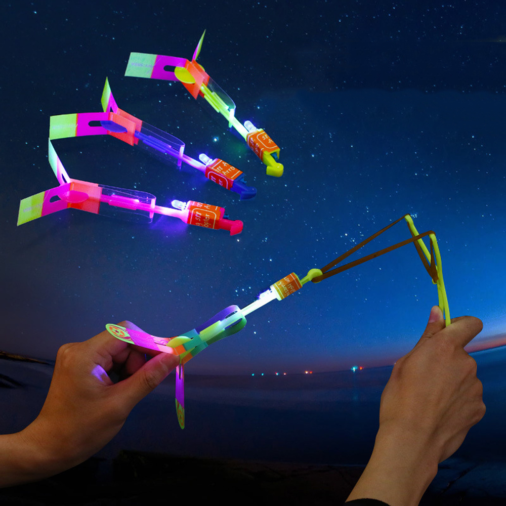 50/100 Pcs Schleuder LED Glowing Copter Kinder Glowing Spielzeug Glow In The Dark Fliegen Spielzeug Leuchtende Rakete Hubschrauber licht Up Spielzeug