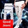 Calça jeans masculinos casuais calças dos homens outono inverno magro juventude moda pés em linha reta calças compridas cantor dançarino impressão de papel da notícia