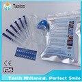Envío gratuito profesional dientes dentales que blanquean Kit sistema de blanqueo de sonrisas blancos dientes Kit de blanqueamiento con luz LED