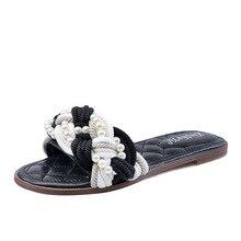 купить Summer Black Satin Pearl Sandals Female Twist Woven Open Toe Flat Beach Slippers Ladies Women Shoes по цене 1404.4 рублей