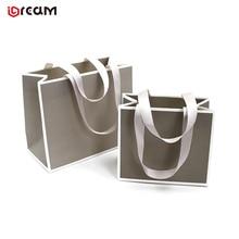 Custom logo new design  luxury jewelry packaging ribbon handle paper bag