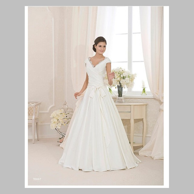 aa86f1da5ff7 High Quality A Line V Neck Floor Length Ivory Satin Cap Sleeve Wedding Dress  With Lace Modest Bridal Gowns