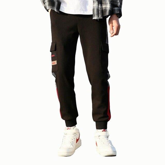 Pantalon de survêtement printemps nouvelle jeunesse hommes outillage décontracté multi-poches pantalon tricot sport faisceau pantalon pantalon marée marque personnalité sauvage