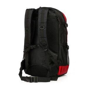 Image 2 - Chuwanglin nouveaux magasins mode chaude hommes sac à dos unisexe en nylon sac de voyage étanche 60L grande capacité sacs pour ordinateur portable S70