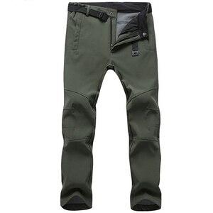Image 1 - Эластичные водонепроницаемые брюки, мужские повседневные зимние плотные теплые флисовые брюки с акулой кожей, Мужская ветровка, спортивные брюки, мужские тактические брюки