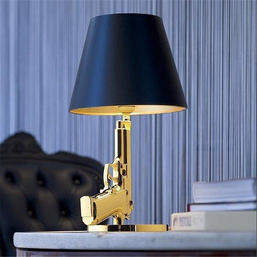 все цены на Luxury Modern Electroplate Gun Table Lamp Light Bedroom Decoration LED Bedside Lamp E27 Gold/Silver Pistol Desk Lamp Luminaire онлайн