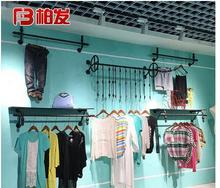 The wall hangers of iron arts clothing store have a vintage display rack mens and womens clothes racks