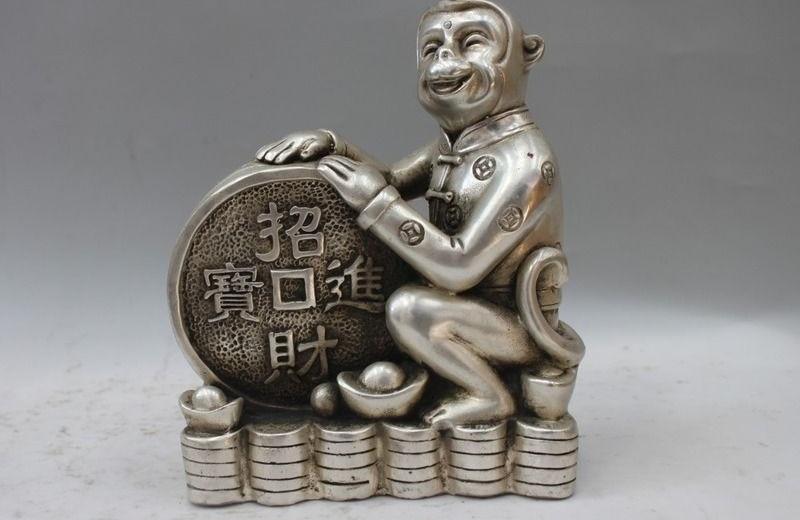 Statue de singe de la richesse YuanBao traditionnelle chinoise en cuivre blanc argentStatue de singe de la richesse YuanBao traditionnelle chinoise en cuivre blanc argent
