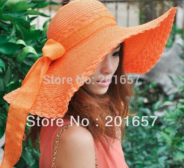 616144c89936a Atacado e Varejo de Moda Mulheres Ampla Grande chapéu da Borda Floppy  Summer Beach Sun Straw Hat Cap com grande arco Frete Grátis
