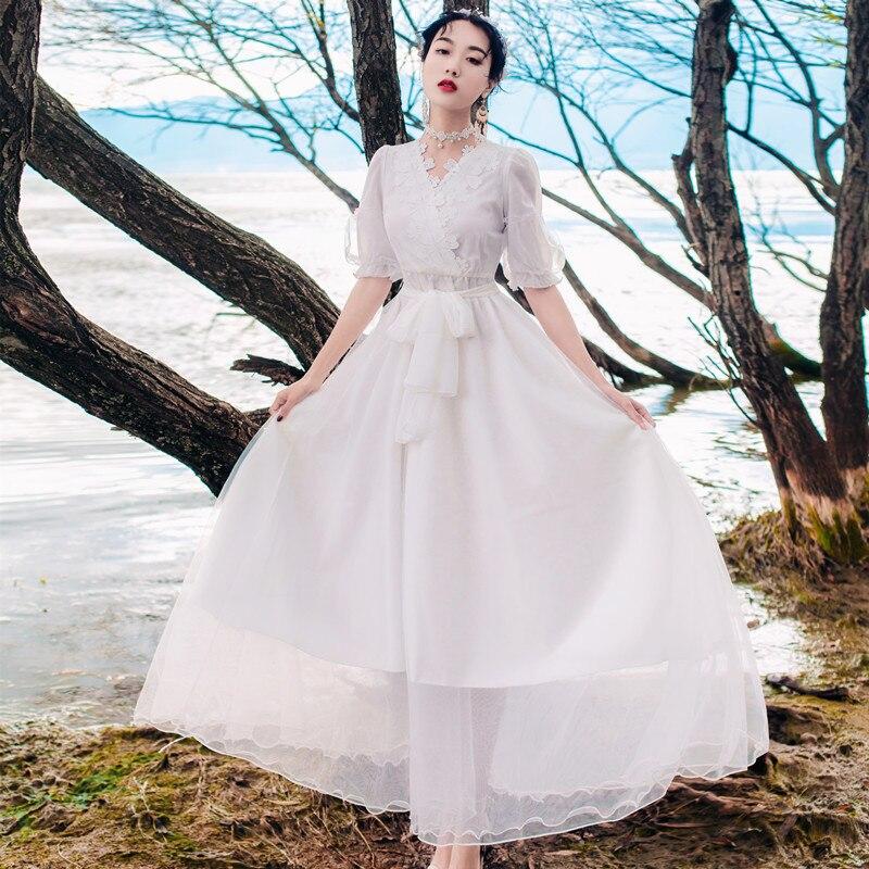 2018 nouveau été broderie dentelle robe femme net fil station balnéaire longue robe d'été