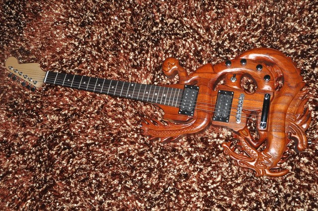 Eccezionale 6 corde chitarra elettrica chitarra Personalizzata Intagliato in  ZI26
