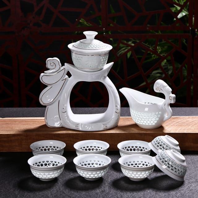 2018 nouveau ensemble de thé en porcelaine Dehua Kung Fu tasses automatiques en céramique blanche creuse transparente bleu et blanc Gaiwan ensemble de tasse de thé