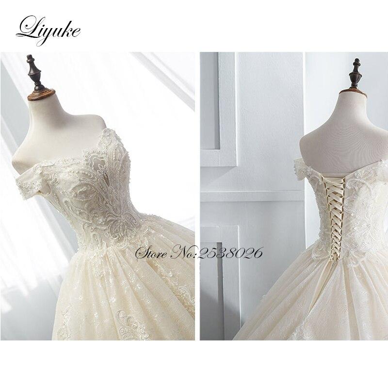 Liyuke Luxurious Princess Ball Gown Wedding Dress Strapless Elegant Beading Chapel Train Bridal Dress Vestido de boda in Wedding Dresses from Weddings Events