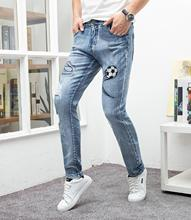 цены на Hip hop jeans men skinng slim fit football embroidery brand pants vogue homme denim trousers plus size 29-38 male blue jeans  в интернет-магазинах