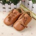 Encantadores bebés bebé de cuero de la PU de los zapatos del pesebre niños niñas Anti Slip zapatos de encaje de 0 - 12 M