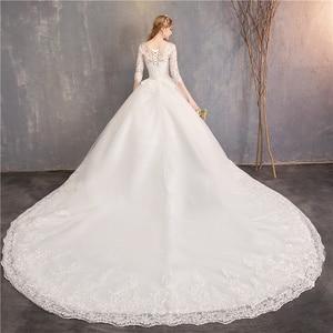 Image 2 - אופנה לבן שנהב תחרה רקמה בתוספת גודל חתונה שמלת חדש Vestidos דה novia מתוקה O צוואר ארוך רכבת bridel חצי שרוול