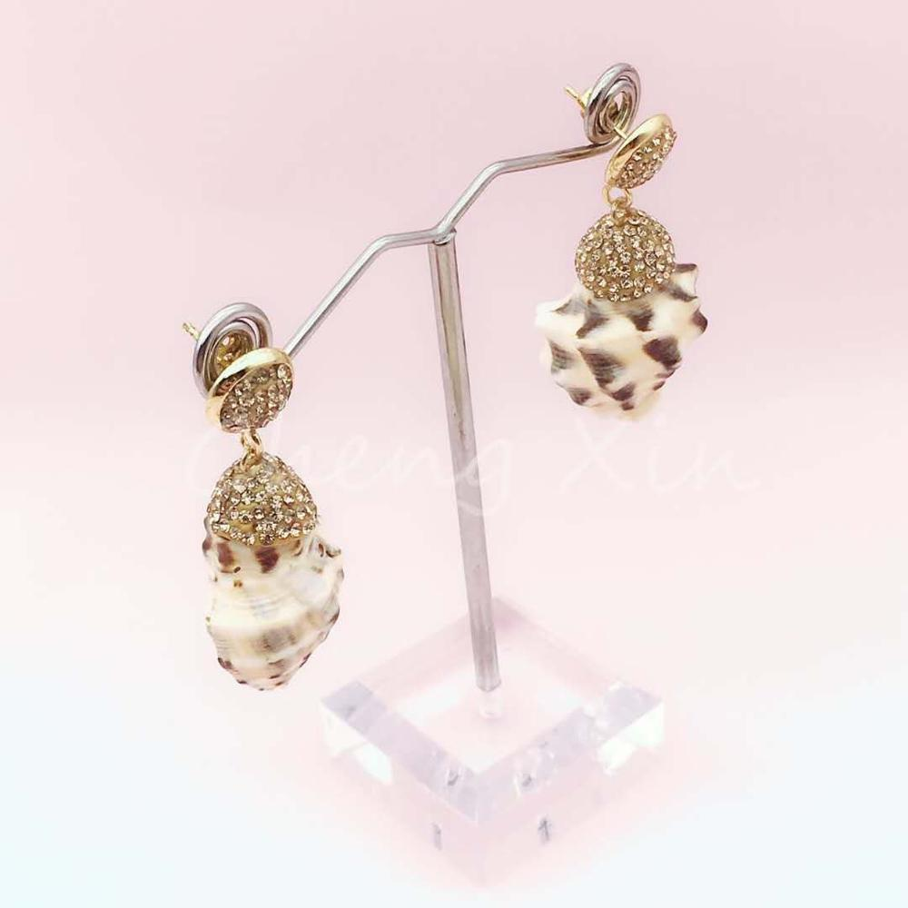 The summer fashionable gem white conch earring that designs for the female is and beautiful