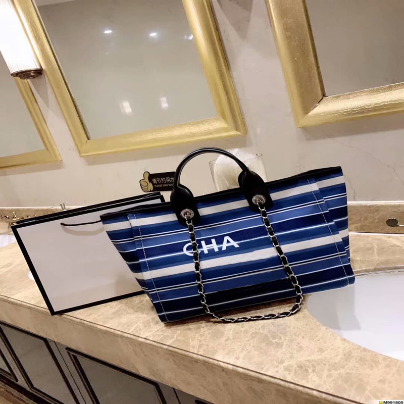 Womens large capacity regular tote bag 2019 spring and autumn new canvas stripes color matching holiday shopping beach handbagsWomens large capacity regular tote bag 2019 spring and autumn new canvas stripes color matching holiday shopping beach handbags