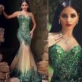 2017 vestidos do baile de finalistas do partido de noite formal pageant dress sereia com sheer neck beads cristais verde oco voltar verde barato