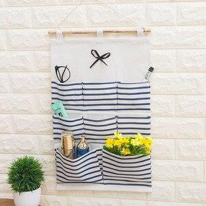 Image 1 - 2019 NEW Organizador Stripe Foldable Hanging Makeup Organizer Bathroom Home Hang Storage Bag Wall Debris Laundry Basket