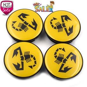 Image 2 - 20 pc/lot 56mm jaune Abarth emblème de voiture roue Center moyeu capuchon jante insigne couvre Scorpion roue central casquettes 5JA601151A