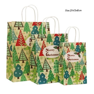 Image 2 - 40 Pcs/lot 21x13x8cm Christmas Paper Bag With Handles Decoration Paper Gift Bag For Christmas Event Party Lovely Cute Paper Bags