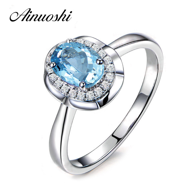 AINUOSHI 2 Carat Oval Gem Halo Ring Oval Cut Natural Blue Topaz Flower Ring Pure 925 Sterling Silver Trendy Female Jewelry GiftAINUOSHI 2 Carat Oval Gem Halo Ring Oval Cut Natural Blue Topaz Flower Ring Pure 925 Sterling Silver Trendy Female Jewelry Gift