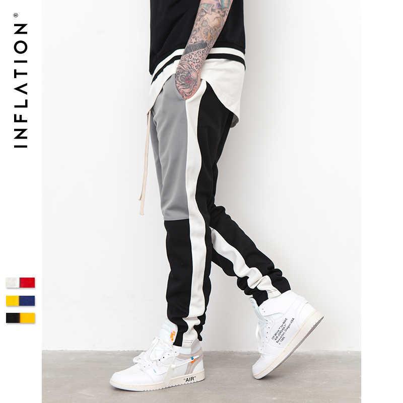 Şişirme erkek motokros eşofman Slim Fit elastik bel çift çizgili dipleri Retro moda Sweatpants 8404S