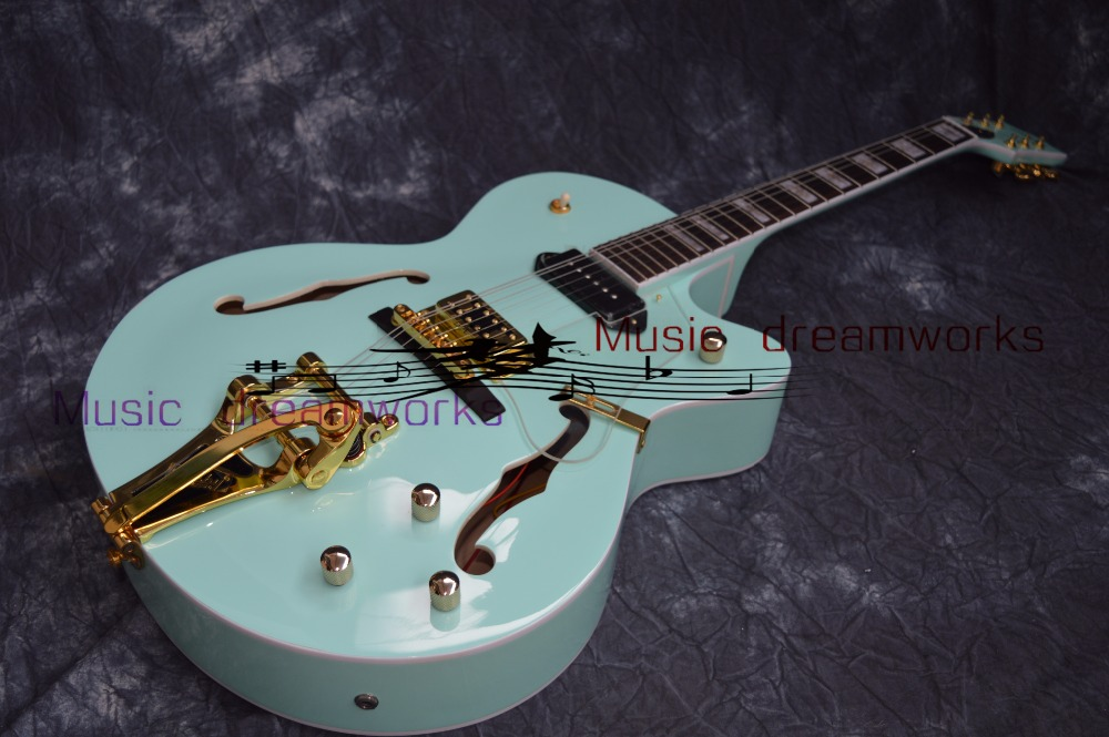 Kinas OEM firehawk Hollow Jazz Electric Guitar med Bigsby Tremolo - Musikinstrument