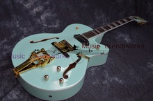 China's OEM firehawk Hollow Jazz Electric Guitar with Bigsby Tremolo Golden Hardware Free Shipping