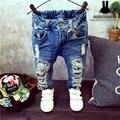 Niños Pantalones Rotos Agujero Pantalones 2015 Muchachas de Los Bebés Del vestido de Los Pantalones Vaqueros de la Marca de Moda 2-7años Niños Pantalones Ropa de Niños
