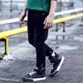 2016 Spring and Autumn fashion boy boy jeans in big children Slim single pants solid color hole elastic jeans plus size hot sale