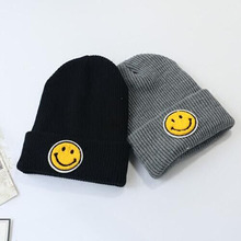 2016 The Smiling Faces of Men And Women Fall And Winter Days Wool Cap Kit Lens Cap Couple Paragraph Labeling Hat Hot Spot