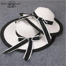 BINGYUANHAOXUAN nuevo verano Bowknot elegante de la sol negro y blanco a  rayas sombrero de paja playa vacaciones sombras doble a. 9ce9da93ea5