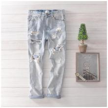 A couple of new holes in jeans men summer light washed white denim pants feet men