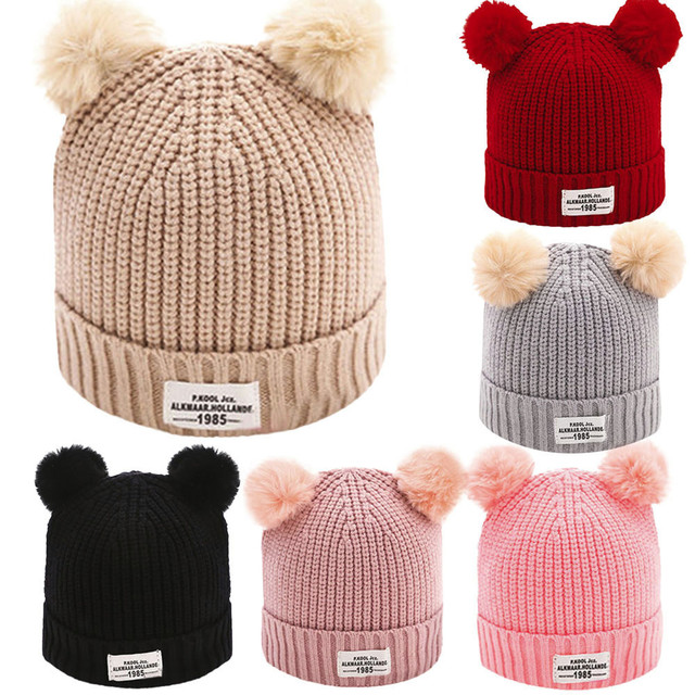 b83b26ddae1 Autumn Winter Fashion Baby Hat Fur Ball Pompom Cap Letter Warm Winter Hats  Knitted Wool Hemming Baby Hat Cap Beanie Suit 0-12M