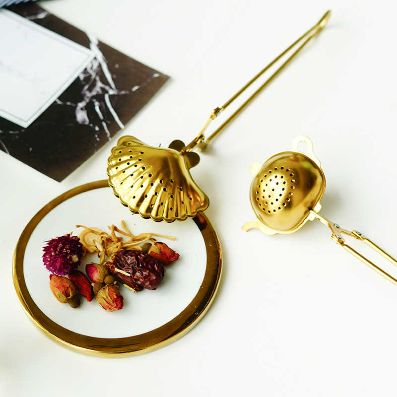 الفولاذ الإبداعي المقاوم للصدأ الشاي المساعد على التحلل المعادن قذيفة القلب ستار نمط قابلة لإعادة الاستخدام الشاي القهوة مصفاة الشاي أدوات إبريق التبعي